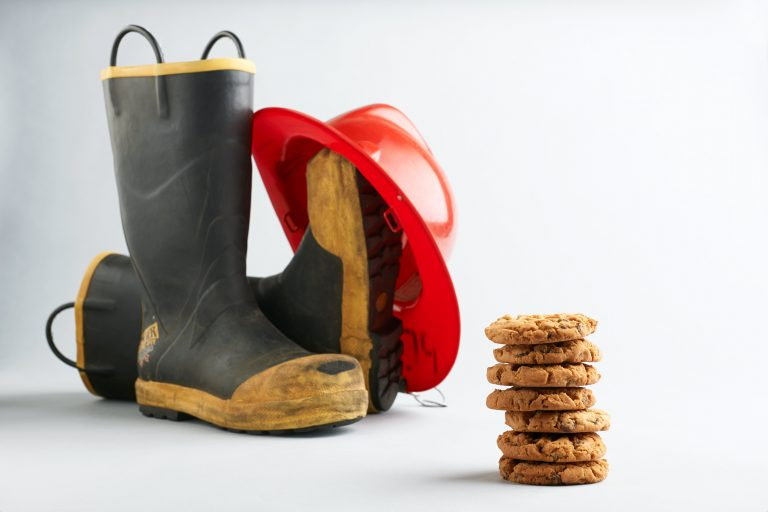 fireman boots and hat with peanut butter chocolate chip cookies